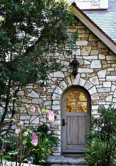 What a rustic entrance! Random pattern stone with an old wooden door!