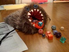 This monstrous dice of bag of devouring was created by Tina of Bags that Bite.