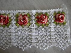 """Looks like a rose trellis.  Nice! No pattern but uses """"lovers knot"""" at the bottom of rose squares"""