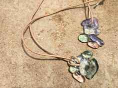 Glass pebbles in pastels. Fused glass, natural leather cord. Terrafuse, by Marian