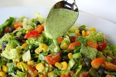 Southwestern Chopped Salad with Cilantro-Lime Dressing. Made with romaine, black beans, orange bell pepper, cherry tomatoes, corn, green onions, and creamy cilantro-lime dressing (cilantro, plain greek yogurt, lime juice, garlic, olive oil, white vinegar, and salt).