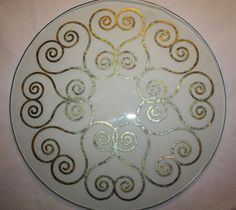 Metallic variegated leaf stenciled end table shelf.  Stencil from Modello Designs.