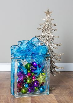Need a quick and easy DIY holiday gift or decoration? Try customizing your own holiday glass block with your choice of ribbon and ornaments for a one-of-a-kind accent piece! Click here to learn more. https://www.menards.com/main/c-1445868983324.htm?utm_source=pinterest&utm_medium=social&utm_campaign=How-To-Center&utm_content=holidayglassblock&cm_mmc=pinterest-_-social-_-How-To-Center-_-holidayglassblock