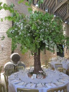 Rachel and Ben had an amazing centrepiece on one of their tables; it featured a huge tree created out of natural materials, with hanging flowers in glass balls and blossom. Around the bottom of the tree was moss and little glass bottles of flowers.