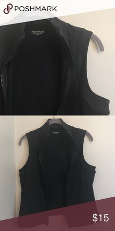 Bebe sport vest Cute zip up vest. Nylon and spandex. Says medium but would fit a small bebe Tops