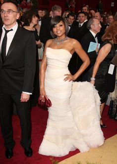 Taraji P. Henson in Roberto Cavalli at the 2009 Oscars with her gown wrangler