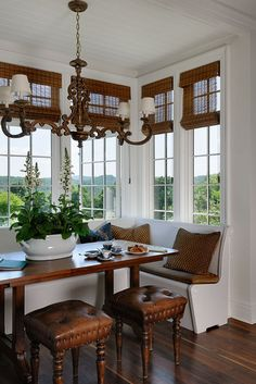 Beautiful breakfast area. Love the use of matchstick blinds with the transom windows.