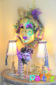 Colorful decorations at a Mardi Gras party! See more party ideas at CatchMyParty.com!
