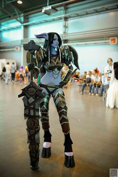 The cosplayer here is Anna, better known as Feyische, and she's impressively transformed herself into a Draenei warrior.