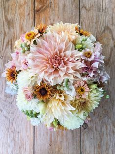 Late summer bridal bouquet in blush and peach with Cafe au Lait dahlias. Grown and designed by Love 'n Fresh Flowers.