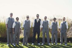 Groom in darker grey. I LOVE this idea! I think the lighter color for the majority is great for summer!! ;)