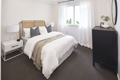 BEDROOM of Malibu 29 single storey home. On display at Housing World Wongawilli. Part of the Evolve range and brought to you by Masterton Homes Home Bedroom, Bedrooms, Malibu Homes, Comfy Sofa, Storey Homes, New Home Builders, Love Home, Open Plan Living, Sliding Glass Door