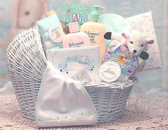 """Welcome Baby Bassinet =   A white wicker baby bassinet gifts the new arrival with the Welcome Baby gift basket. This is a keepsake that will last long after baby grows up. Filled with special """"firsts"""" like a baby lamb picture frame and baby lamb """"my first bank"""" as well as baby necessities and a plush baby lamb, this basket brings the book """"A Baby Is..."""", a book of love thoughts for baby. Give the Welcome Baby gift basket.  WWW.LEEANNA.LABELLABASKETS.COM  #WeGiveBack #LeeannasLaBellaBaskets…"""