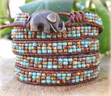 BEADED ELEPHANT LEATHER WRAP BRACELET, SEED BEADBRACELET, SEED BEAD LEATHER WRAP BRACELET.  THIS IS MADE TO WRAP AROUND YOUR WRIST 5 TIMES.  PLEASE MEASURE YOUR WRIST SIZE BEFORE YOU ORDER THANK YOU FOR STOPPING BY,PLEASE CONTACT ME IF YOU HAVE ANY QUESTIONS.  PLEASE READ MY SHOP POLICIES BEFORE PURCHASE:  CONTACT ME FOR SHIPPING OUTSIDE THE USA