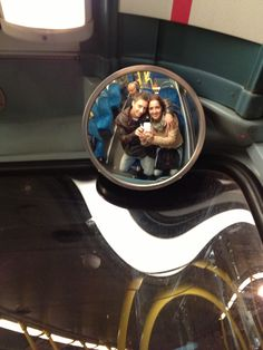 A different take on the mirror selfie. Take a picture with the bus mirror.