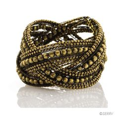 Braided Brass Cuff  Interwoven brass beads glint with an antique finish. Flexible. Fits most wrists Made in India $17