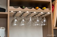 Shown in Chateau, this reach-in pantry features a central entertainment hub, with angled wine bottle racks in four- to six-bottle widths, a stemware holder to store precious glassware, and a convenient surface for preparing and serving drinks. Pantry Storage, Pantry Organization, Custom Pantry, Wine Bottle Rack, Simple Closet, Pantry Design, Closet System, Easy Closets, Surface