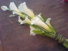 calla lillies | Arum lily and calla lily sheaf bouquet, with lily-of-the-valley ...