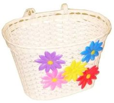 White plastic bike basket with flowers - great for collecting treasures