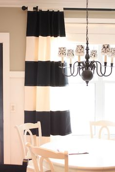 no-sew, no-paint striped curtains using fabric attached with fusible webbing, with grosgrain ribbon to cover the edges of each stripe