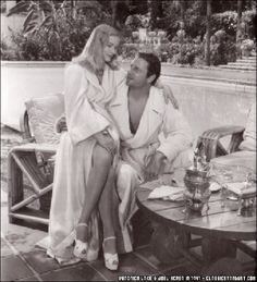 Veronica Lake and Joel McCrea. Clearly these are their robes for lounging by the pool.