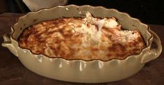 Hot Crab Dip  1/2 yellow onion, shredded 2 cups swiss cheese, shredded 1 1/2 cup sour cream 1 package of imitation crab meat 8 oz package of cream cheese Salt & Pepper to taste 1. Preheat oven to 350 degrees 2. Use mixer to blend all ingredients 3. Put in baking dish and bake for 45min. - 1hr till golden brown. 4. Serve with crackers
