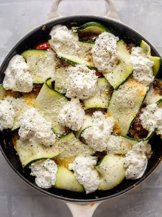 This zucchini skillet lasagna is made with a burst cherry tomato sauce, topped with creamy ricotta and baked to perfection. It's so good and perfect for a late summer weeknight meal.