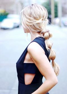 "Secure clear elastics along your low ponytail, pulling each section apart to create a ""bubble"" effect"