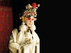 Leslie Cheung in the movie 'Farewell My Concubine' which won the best film at the Cannes Film Festival. Leslie is wearing Peking Opera costume. Top 10 classic TV and film characters in China.