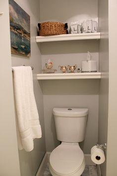 DIY built in storage shelves in bathroom