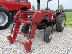 585 utility tractor with  Buhler 495 loader