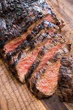 Grilled Marinated Flank Steak ~ A melt in your mouth flank steak that is cooked quickly with a high heat. The marinade of soy sauce, honey and garlic does the trick for this cut of meat. from Simply Recipes Marinated Flank Steak, Flank Steak Recipes, Grilled Steak Recipes, Grilled Meat, Grilling Recipes, Meat Recipes, Cooking Recipes, Beef Flank, Water Recipes
