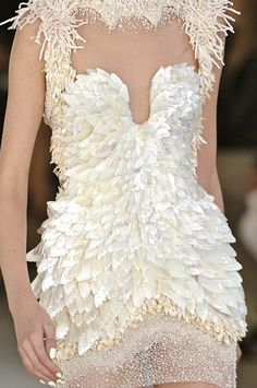 Alexander McQueen, model, runway, haute couture, couture, fashion, high fashion, Paris Fashion Week, fashion week, pearls, sequins, feathers, shells, fringe, chiffon, tulle, sheer, beading, detail, embroidery, coral, corset, Alexander McQueen Couture, couturier, atelier, fashion designer, Sarah Burton, seed pearls, mermaid, Spring 2012,