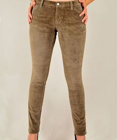 Durable, soft corduroy pants never go out of style. This skinny pair offers a bit of stretch for a sleek and chic silhouette.