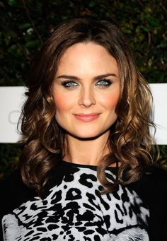 "Wispy lashes and a dark waterline make for a simple but pretty eye makeup look, seen here on Emily Deschanel at a screening Of ""Home"" in West Hollywood."