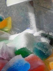 "All you need is ice, salt, and food coloring.  Place the ice in a sensory table or a clear plastic storage container and then allow the child to do the rest - pour the salt and listen to the ""music"" it makes - add food coloring to make it even more inviting - touch it, stir it, smell is, taste it (yuk),"