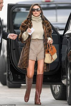 Hollywood Model, Actress and Beauty Queen Olivia Culpo Shows Off Her Eclectic Style in Orseund Iris Cropped Ribbed-Knit Turtleneck Sweater, Fendi Striped Faux Fur Coat and Long Brown Shoes at Out in Los Angeles on Olivia Culpo, Olivia Palermo Fur, Star Fashion, Fashion Outfits, Womens Fashion, Fashion Trends, Red Fashion, Fendi Fur Coat, Fur Coats