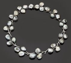 A cultured pearl and diamond necklace  of foliate design, with a series of baroque-shaped gray cultured pearl clusters with round brilliant-cut diamond detai