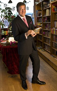 Stephen Fry with books.