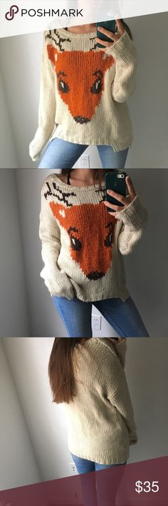 Cozy Deer Sweater The perfect fall sweater! This sweater is made out of a heavy yarn that is sure to keep you warm during the chilly months. It is starting to fuzz up a little and there is one little snag that is pictured above, but both are hardly noticeable. There is also a high-low dip on the front as part of the sweater's design. Sweaters Crew & Scoop Necks