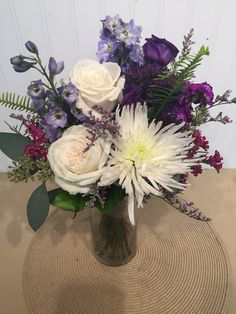 A purple and white bride's maids bouquet.