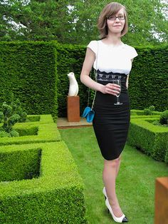 Celebrating the 200th post on blackdresszone.com with a glass of white wine at a garden party in the grounds of a gorgeous country manor, on Friday. I finally got to wear my new monochrome bodycon dress, in a black and white colour block ensemble with a splash of teal from my clutch. It was such a wonderful evening, with lovely drink, live music and art. SS14 Lookbook - to see details click here.