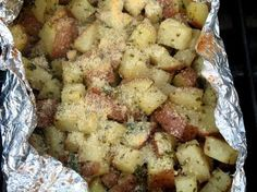 1 lb small red potato  1/4 cup green onion , chopped  2 teaspoons vegetable oil  1 tablespoon parmesan cheese , grated (I add alot more, so to taste)  1 teaspoon dried oregano  1/2 teaspoon garlic salt (I add about 1 teaspoon, to taste)  1/4 teaspoon pepper (I add about 1/2 teaspoon, so to taste)