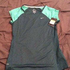 NWT Nike Short Sleeve Shirt Never worn!  Longer fitted shirt.  Mesh vents on side.  Dry fit material. Nike Tops Tees - Short Sleeve