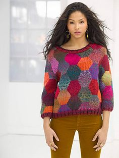 Feel cheery and energetic when you wear this beautiful knit sweater, made with the multicolored shades of Unique.