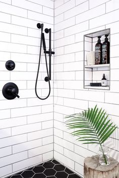 Retro Home Decor Shower clad in white subway tile and black hex with contrasting grout.Retro Home Decor Shower clad in white subway tile and black hex with contrasting grout. White Subway Tile Bathroom, Subway Tile Showers, Black White Bathrooms, Bathroom Black, Master Bathroom, White Tiles Black Grout, White Subway Tile Backsplash, Grey Grout, Minimal Bathroom