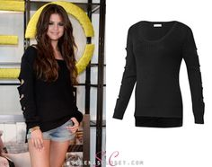 The moment (or sweater) you've all been waiting for has finally arrived! Back in July Selena Gomez attended an adidas NEO press event in Berlin, and got us all flustered over her cut-out arm sweater. We can now confirm that this adidas NEO SG Knit Sweater is on sale from adidas.com for $40.00. Buy it HERE She also wore adidas: denim shorts and shoes. Like what you see?! Shop the rest of Selena's adidas NEO collection here: