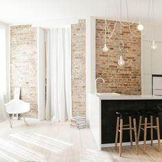 'Poor but Sexy' is a recently renovated apartment that uses the original building materials as its main feature, designed by Hagar Abiri