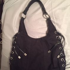 Kenneth Cole Reaction Purse Gently Used Kenneth Cole Reaction Hobo bag. Black canvas with black leather braided down each side. Kenneth Cole Reaction Bags Hobos