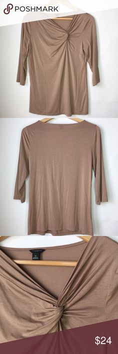 """Ann Taylor 3/4 Brown Blouse Size M Excellent condition, like new! Size medium. Color brown. 3/4 Sleeve. Fabric: 65% Rayon, 28% Tencel, 7% spandex. Chest flat across 17"""", length from shoulder to bottom 25"""". Fabric it's stretchy. Ann Taylor Tops Blouses"""